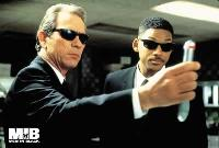 "Special agents K and J ""flashy-thing"" an eye witness to erase his memory in the movie Men in Black"