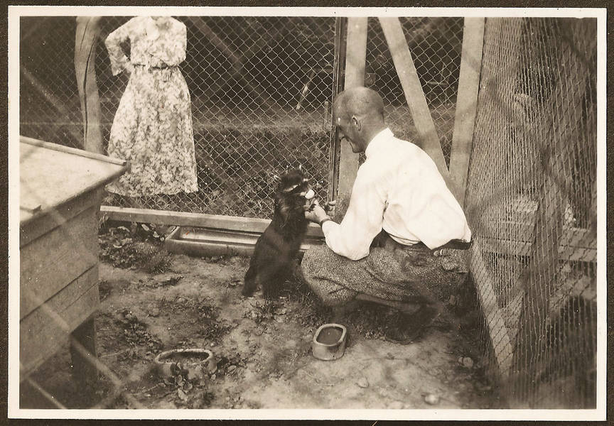 Rolf Haag and one of his raccoons, photo taken by Christoph Haag